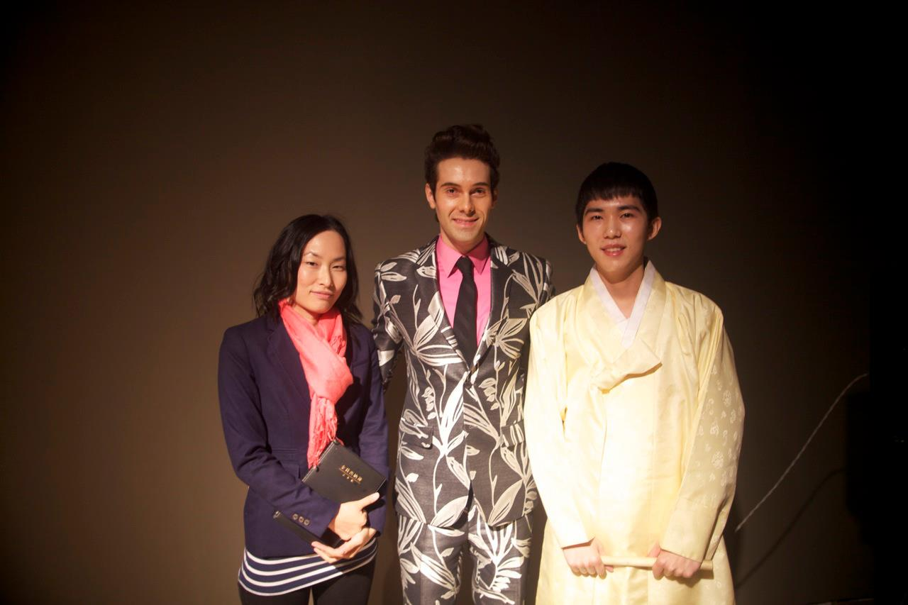 With drummer and translator after performance.