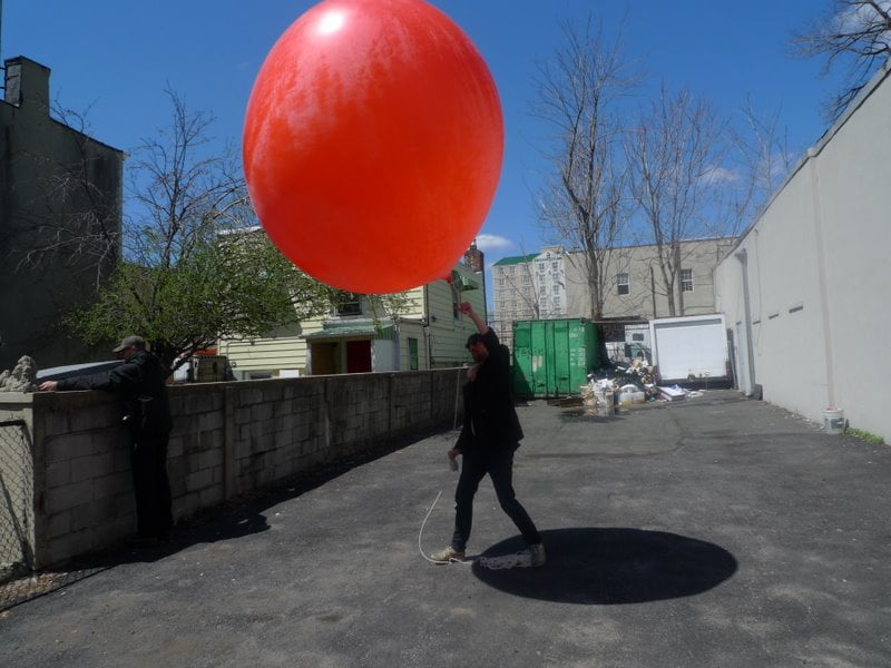 RU's Director of Operations, Sebastien Sanz de Santamaria, tries to reign the weather ballon in heavy winds.