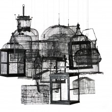 Traps for Clouds, 2011, 18 cages hanging to the ceiling, black enamel, dimension variable.